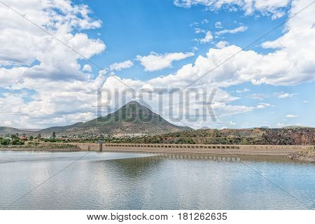 The Nqweba Dam with part of Graaff Reinet a town in the Eastern Cape Province of South Africa visible in the back