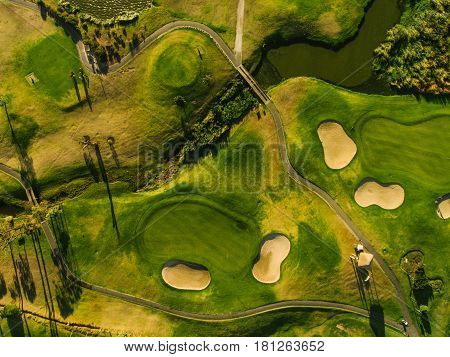 Aerial view of golf course fairway and green. Top view of beautiful green golf course.