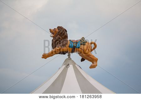 Lion over the dome of the carousel in the town square