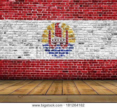 French Polynesia flag painted on brick wall with wooden floor