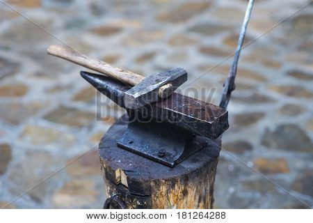 Metal fabricator utilizing a torch to heat up a piece of metal in order to shape it utilizing a forging technique developed over hundred years ago.