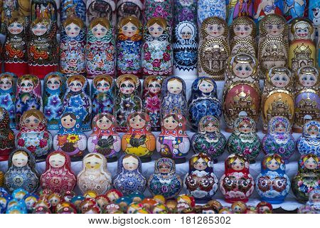 Beautiful colourful wooden dolls matryoshka at market. Matryoshka dolls is folks cultural symbol of Russia.