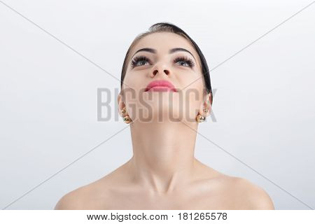 Front portrait of female neck on the grey background close up. girl with clean and lifted skin