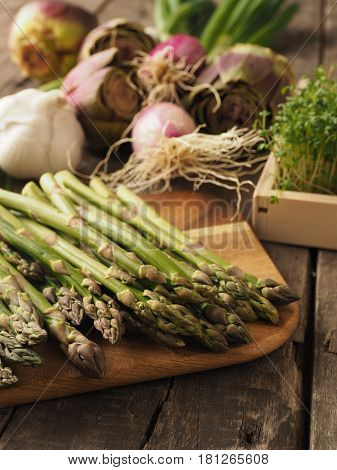Healthy food concept with organic vegetables on a rustic wooden table natural light with selective focus