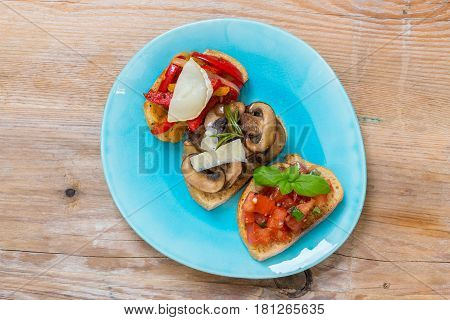 Bruschetta with tomatoes mushrooms goat's cheese picture