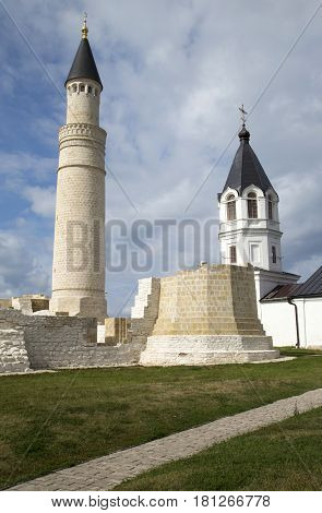 Christianity and Islam together. Big Minaret Complex and Assumtion Church in ruins of Bolgar ancient city on Volga river, archaeological site near Kazan, Tatarstan, Russia