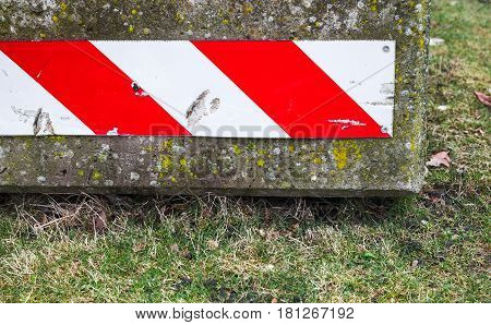 Concrete Road Block With Warning Sign, Closeup