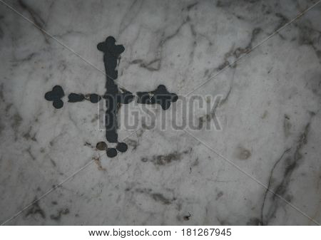 Religious cross on a marble in sienna italy