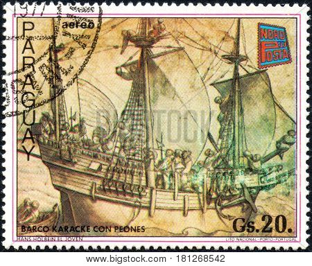 UKRAINE - CIRCA 2017: A postage stamp printed in Paraguai shows Karacke boat with pawns from the series Paintings German ships circa 1977