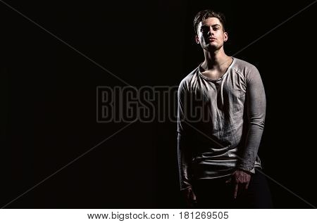 Handsome Man With Stylish Haircut In Dark Tshirt