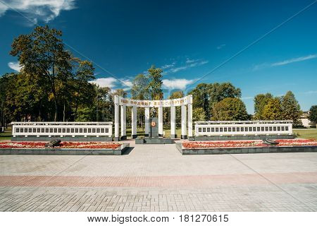 Gomel, Belarus. Monument Dedicated To Memory Of The Great Patriotic War. Memorial Is Situated Near Student Square On Sovetskaya Street In A Summer Sunny Day. Inscription Is Your Feat Is Immortal