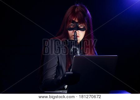 Hacker with finger at mouth