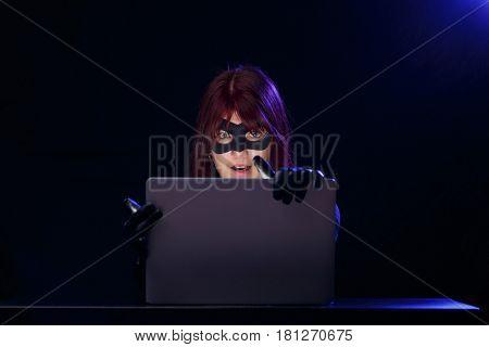 Night photo of female hacker