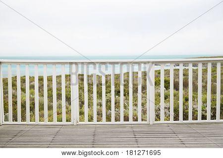 Wooden decking at railing at resort background