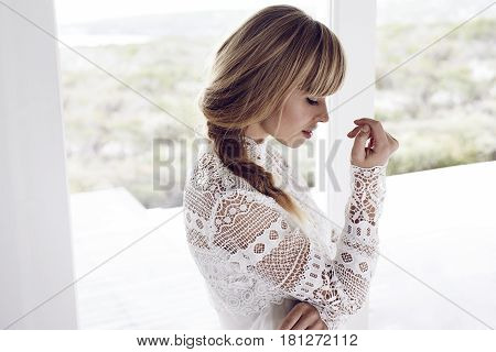 Young blond woman in chic boho style top