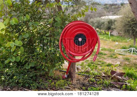 Fire safety concept - an fire hose hanging outdoors.