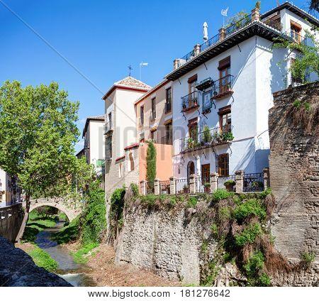 Old buildings on Carrera del Darro street in beautiful spring day, Granada, Spain.
