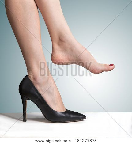 wearing high heeled shoes and bare feet