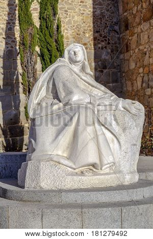 Avila Spain - April 18 2014: Monument of Saint Teresa of Avila Placed along with the south wall of the city