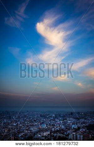 Smog over the urban landscape at sunset