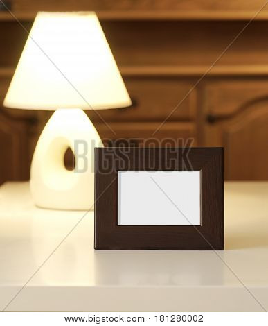picture frame with lampshade on the table