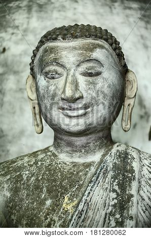 A statue of a young Buddha sits inside one of the caves in the cave temple complex at Dambulla near Kandalarma in Sri Lanka.