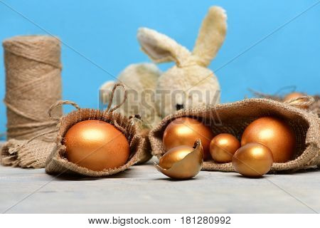 Easter Rabbit Toy, Golden Eggs In Broken Shell In Burlap