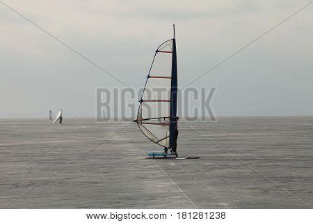 windsurfer Ice surfing Extreme winter sport Finnish Gulf near St. Petersburg