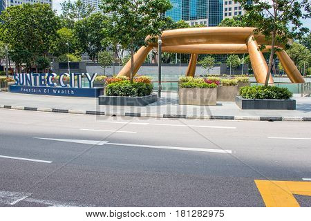 SINGAPORE - MAR 21, 2017 : Bottom view of fountain of wealth at Suntec City. Suntec City is the largest fountain in the world with a golden ring in the side of fountain the city at Singapore.