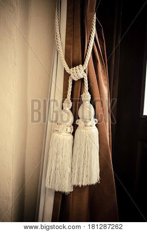 Curtains tied with white tassel in the hotel