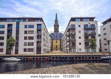 Waterside living in Christianshavn and Christian's Church between modern apartment building Copenhagen Denmark