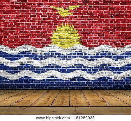 Kiribati flag painted on brick wall with wooden floor