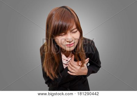 Businesswoman having heart attack - Angina Pectoris Myocardial Infarction - office syndrome