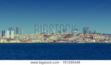 ISTANBUL, TURKEY - 3 APRIL , 2017: Panorama of view from the Golden Horn on the duct slopes City
