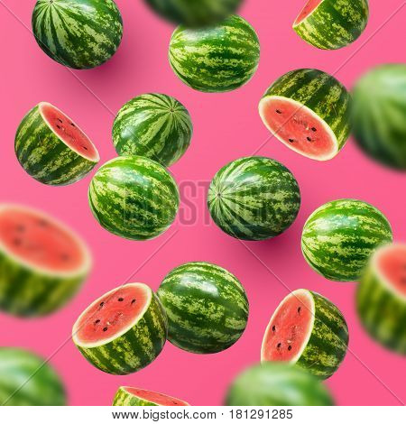 Delicious and juicy sweet watermelons sliced and whole on a pink summer background.