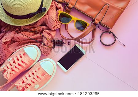 clothing for women placed on pink floor.