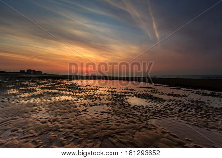 Dramatic colorful sunset on the beach in Ostend Belgium