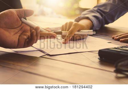 Team businessman job . working with laptop in open space office. Meeting report in progress