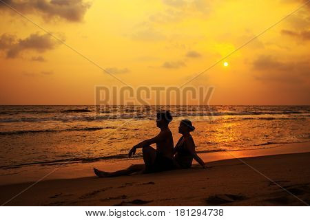 Silhouettes Of A Loving Couple On The Ocean Shore.