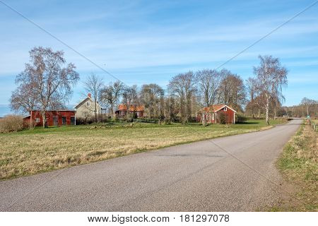 HORNBORGA, SWEDEN - APRIL 7, 2017: Rural Sweden near Lake Hornborga in Vastergotland during early spring.  9000-year-old remnants of stone age civilizations have been found in this area.