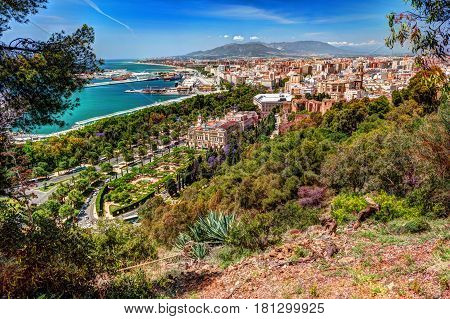 Aerial view of Malaga taken from Gibralfaro castle including port of Malaga, Alcazaba castle and the Cathedral, Andalucia, Spain.