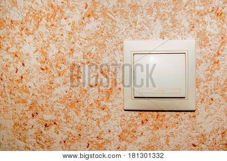 Electrical beige rocker light switch on wall