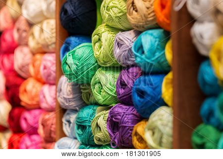 shelves with colorful wool and yarn in a knitting shop