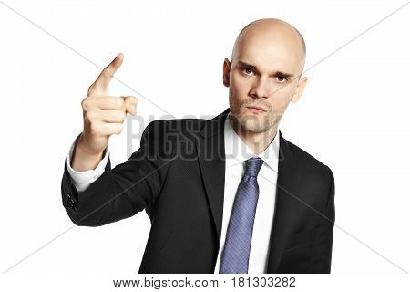 Young menacing man threatens his finger. Isolated on white background.