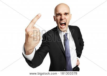 Studio shot of young furious businessman threatens his finger. Isolated on white.