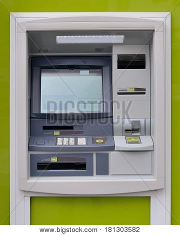 image of ATM machine on green background