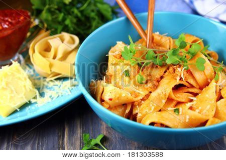 noodles with tomato sauce and minced meat and micro greens