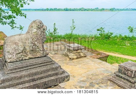 The Stone Lion At The Lake