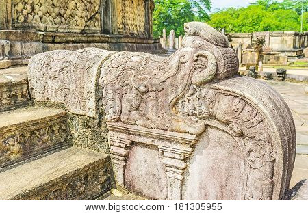 The reliefs on preserved moonstone carved stairs and Naga-raja statues at the entrance to the Vatadage (Stupa House) at Dalada Maluwa area of the sacred city of Polonnaruwa Sri Lanka.