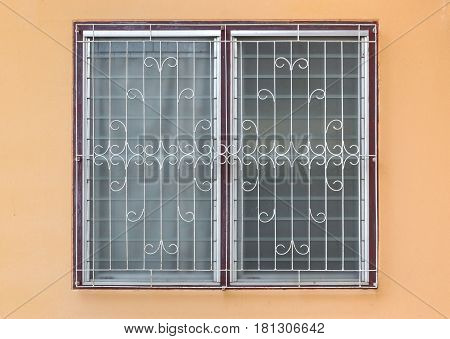 Frosted Glass Louver Windows With Curved Steel On Orange Concrete Wall